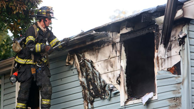 Putnam Lake firefighters work at the scene of a house fire at 9 Hermitage Road in the Putnam Lake section of Patterson, July 21, 2016. No injuries were reported.