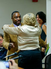 Departing second ward alderman J.R. Clairborne hugs city clerk Julie Holcombe after giving a farewell speech Thursday afternoon at City Hall. Clairborne was the longest-tenured member of Common Council, having served 10 years.