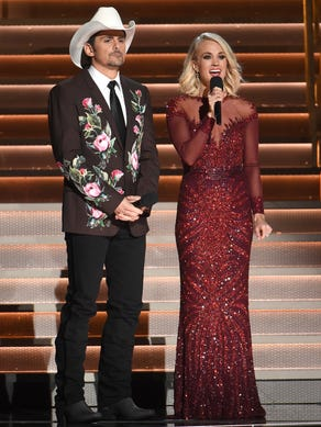 Hosts Brad Paisley, left, and Carrie Underwood speak
