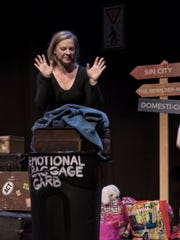 """Murphy Funkhouser Capps disposes of some of her baggage in a recent performance of """"Carry On"""" at the Asheville Community Theatre."""