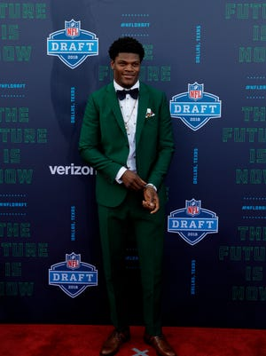Louisville's Lamar Jackson walks the red carpet before the first round of the 2018 NFL football draft, Thursday, April 26, 2018, in Arlington, Texas. (AP Photo/Eric Gay)