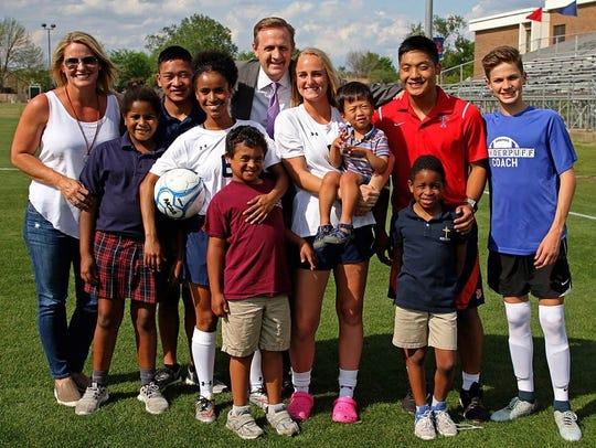 Full family photo: L to R – Joy, Emme, Samuel, Zoe,