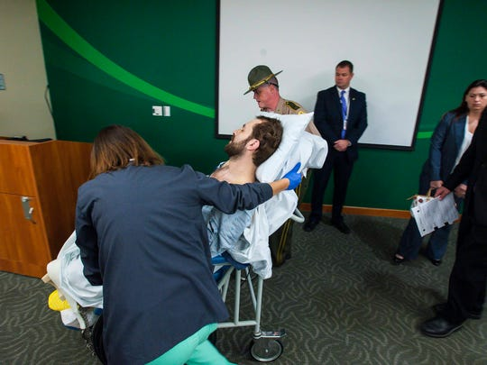 Stephen Bourgoin is wheeled out after being arraigned in Vermont Superior Court in Burlington on Friday, October 14, 2016, on 5 counts of second-degree murder stemming from a head-on crash on I-89. Bourgoin was arraigned in a makeshift courtroom at the University of Vermont Medical Center where he is lodged due to injuries suffered in the crash.