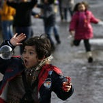 Migrant children play with soap bubbles as they wait to be taken to the train station in Sid, in Adasevci, about 60 miles west of Belgrade, Serbia, on Jan. 11.