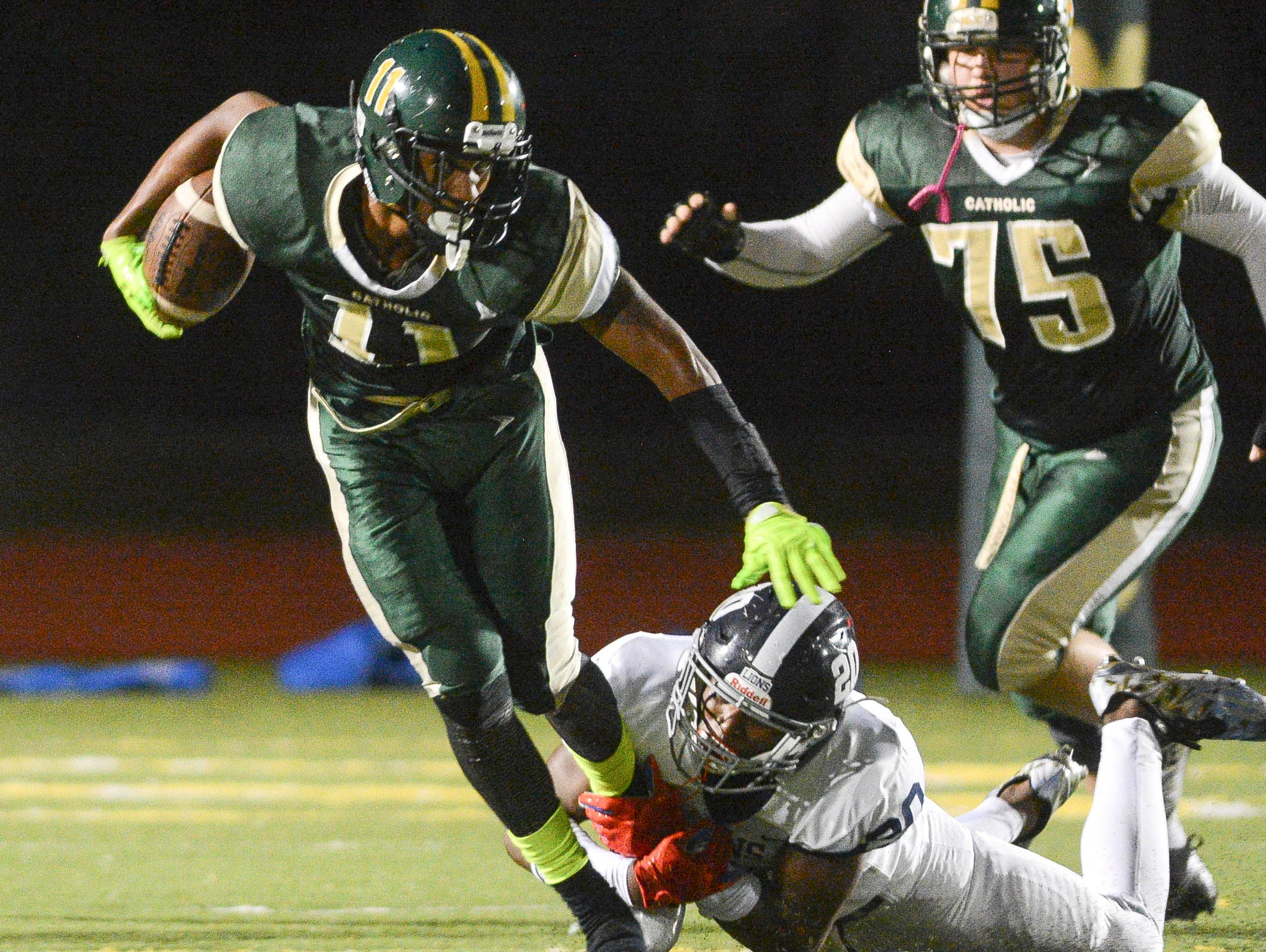 MCC's Lorenzo Hardy tries to get past Chaminade-Madonna defender Keontra Smith (20) during Friday's Class 3A semifinal.
