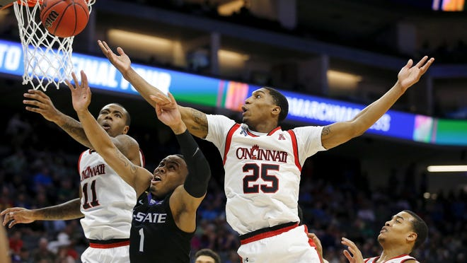 Cincinnati Bearcats guard Kevin Johnson (25) goes up for a rebound in the first half during the first-round game of the men's NCAA college basketball tournament between the Cincinnati Bearcats and the Kansas State Wildcats, Friday, March 17, 2017, at the Golden 1 Center in Sacramento, California.
