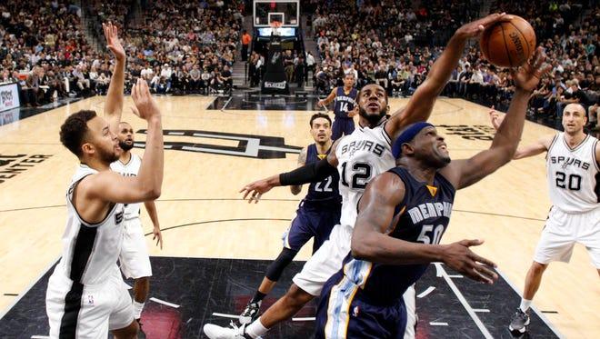 Memphis Grizzlies power forward Zach Randolph (50, front) has his shot blocked by San Antonio Spurs power forward LaMarcus Aldridge (12).