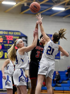 Dover's Rajah Fink, center, passes the ball against Kennard-Dale's Lexie Kopko and Jaedyn McKeon in the first half of a YAIAA girls' basketball game Friday, Jan. 19, 2018, at Kennard-Dale. Dover defeated Kennard-Dale 49-44 in overtime.