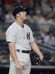 New York Yankees pitcher David Robertson reacts after giving up a two-run home run to the Cleveland Indians during the eighth inning of a baseball game Friday, May 4, 2018, in New York.