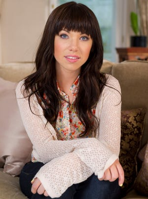 This photo taken April 19, 2012 shows Canadian singer, Carly Rae Jepsen, posing for photographs following an APTN interview at the Landmark Hotel, London.  Jepsen has been called by Broadway. Producers of 'Rodgers + Hammerstein's Cinderella' said Sunday that the Canadian singer-songwriter will take over the role of Cinderella starting Feb. 4 for 12 weeks.