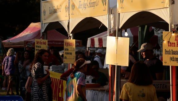 Food vendor booths on the opening day of Festivals