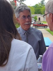 Devery Quandt visits with well-wishers at his retirement