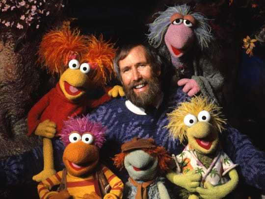 "Jim Henson with puppets from ""Fraggle Rock."""