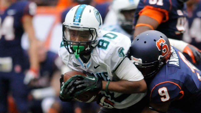 Tulane wide receiver Justyn Shackleford (80) makes a catch against Syracuse in a game on Sept. 21, 2013.