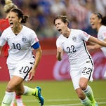 United States' Carli Lloyd (10) reacts after scoring on a penalty kick against Germany as Meghan Klingenberg (22) follows during the second half of a semifinal in the Women's World Cup soccer tournament, Tuesda in Montreal, Canada.