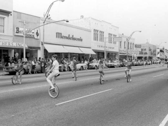 Some people are better at riding unicycles than others. This photo was taken during the Springtime Tallahassee parade in 1970.
