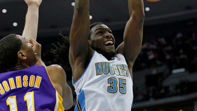 Denver Nuggets small forward Kenneth Faried (35) dunks the ball against Los Angeles Lakers small forward Wesley Johnson (11).