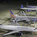US Airways and American Airlines, which merged in December 2013, will combine their frequent flier programs by mid-April