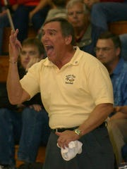 Naples Girls' Basketball Head Coach Dave Walker yells directions to one of his players during their regional semifinal game versus Lakeland Kathleen in Naples on Feb. 14, 2006.