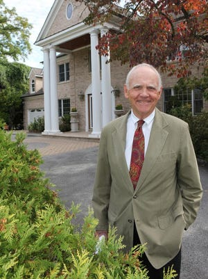 Realtor Frank Haymson stands at one of the properties he is listing in Harrison Sept. 29, 2014. Haymson was the realtor who sold Ron Howard's Armonk home.