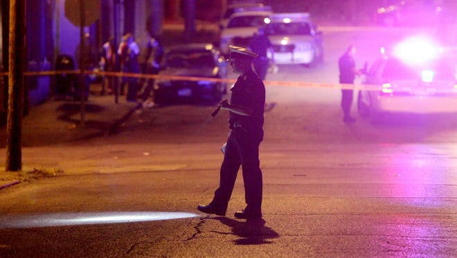 Police investigate a shooting in Lower Price Hill Tuesday night. A 17-year-old male was shot in the back. He was hospitalized and is expected to survive.