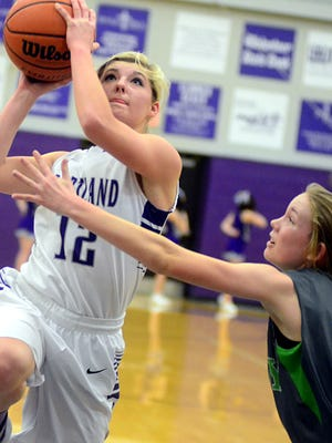 Portland senior guard Erica Keen elevates for a layin in front of Station Camp sophomore Carolyn Fitch during first-quarter action. Keen scored seven points.