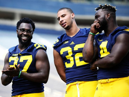 From left, Michigan running backs Derrick Green, Ty Isaac and De'Veon Smith.