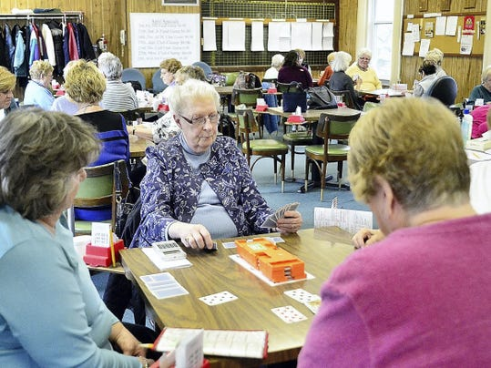 Members of the White Rose Bridge Club play a hand at the Lancaster Avenue location in Spring Garden Township Tuesday, March 31, 2015. Randy Flaum photo