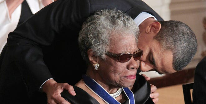 President Obama kisses author and poet Maya Angelou after awarding her the Medal of Freedom on Feb. 15, 2011.