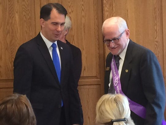 Wisconsin Gov. Scott Walker chats with a constituent