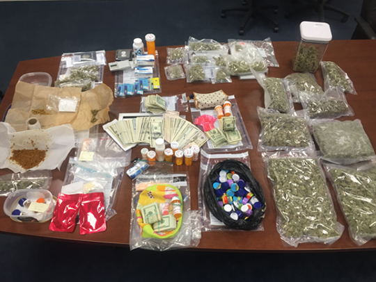 Pills and drug paraphernalia  seized from Pearl River