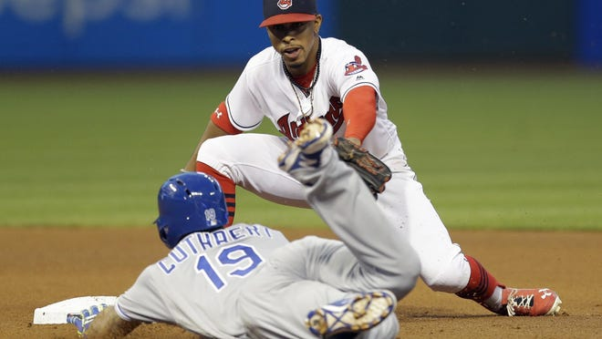 Cleveland Indians' Francisco Lindor, back, tags out Kansas City Royals' Cheslor Cuthbert at second base in the seventh inning Friday in Cleveland. Cuthbert tried to stretch a single into a double.