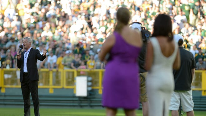 Favre's family looks on as he addresses the crowd as he is honored at Lambeau Field in Green Bay, Wis. on Saturday, July 18, 2015. Kyle Bursaw/Press-Gazette Media/@kbursaw