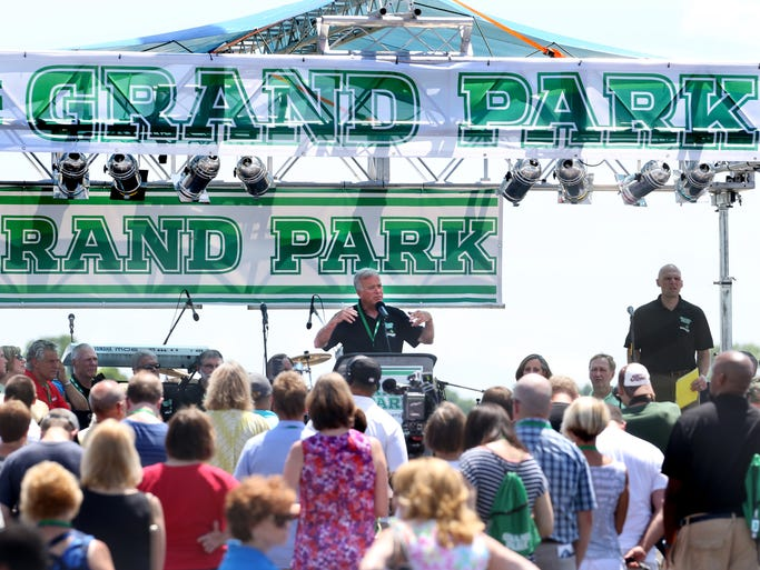 Westfield Mayor Andy Cook makes comments to the hundreds of people that turned out for the grand opening ceremony for Westfield's Grand Park, which, when finished, will be the country's largest multipurpose youth sports complex, on Saturday, June 21, 2014. The three-day celebration that began on Friday includes live music, a Ferris wheel, food and fireworks, and of course a youth sports tournament. The facility has 31 multi-use soccer/football fields and 26 baseball/softball diamonds throughout 400 acres.
