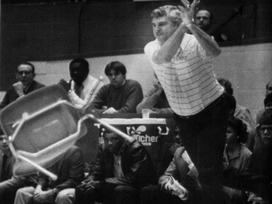 Indiana University basketball coach Bobby Knight throws a chair in protest of officiating at a basketball game against Purdue University in Bloomington.