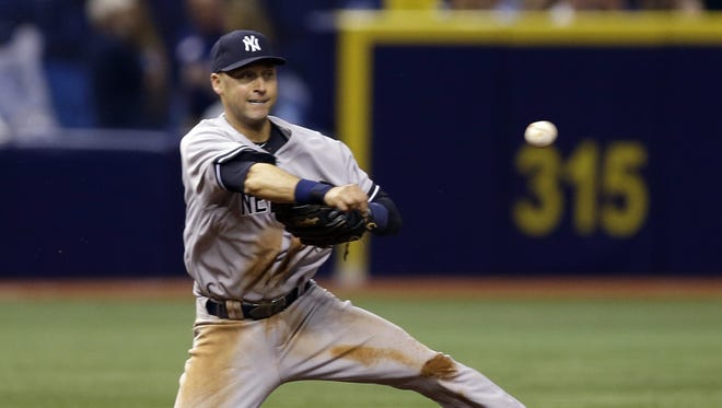 Yankees shortstop Derek Jeter starts a double play against the Tampa Bay Rays during the fourth inning of Thursday night's game in St. Petersburg, Fla.