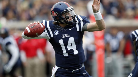 Mississippi quarterback Bo Wallace (14) passes against Louisiana-Lafayette during the first half at an NCAA college football game at Vaught-Hemingway Stadium in Oxford, Miss., Saturday, Sept. 13, 2014. No. 14 Mississippi won 56-15. (AP Photo/Rogelio V. Solis)
