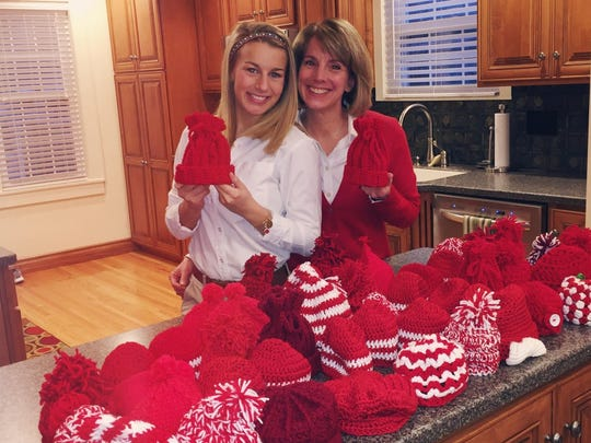 "Healthy heart hats The Schnautz ladies: Adele, Lynn, Lillian and Elinor, have been very busy crocheting red baby hats for the Heart Hospital's ""Healthy Hearts from the Start."" The talented foursome crocheted 50 red baby hats for the campaign that kicked off in February.  Every baby born at The Women's Hospital will receive a red baby hat, and their mother will receive literature on how to keep their baby's heart healthy. The hats were presented on National Kawasaki Disease Awareness Day, the No. 1 cause of acquired heart disease in children. In the photo are Adele, a KD survivor and Lynn, a nurse practitioner at the Heart Hospital."