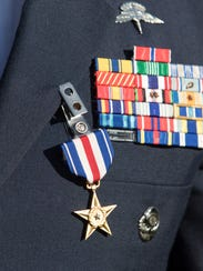 Staff Sgt. Christopher Lewis wears his Silver Star