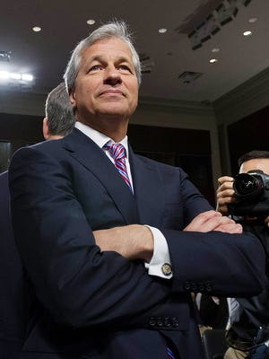 (FILES) Jamie Dimon, chairman of the board, president and CEO of JPMorgan Chase & Co. testifies before a US Senate Banking Committee hearing in this June 13, 2012 file photo in Washington, DC.