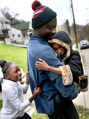 Abdoulaye Drame plays with his daughters Mariama, 8,