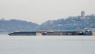 An oil barge pushed by a tugboat toward the upper reaches of the Hudson River.