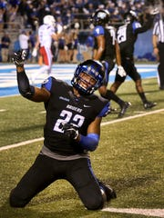 MTSU's Alex Dale (22) drops to his knees and celebrates on the field after holding Louisiana Tech with seconds left in the game on Saturday, Sept. 24, 2016.