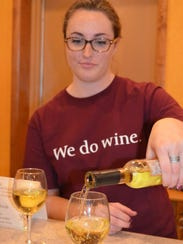 Bellview Winery employee Dana Milligan pours a glass