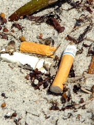 Cigarette butts on a beach.
