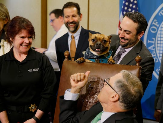 Sen. Guy Palumbo, D-Maltby, right, holds Smudge, a
