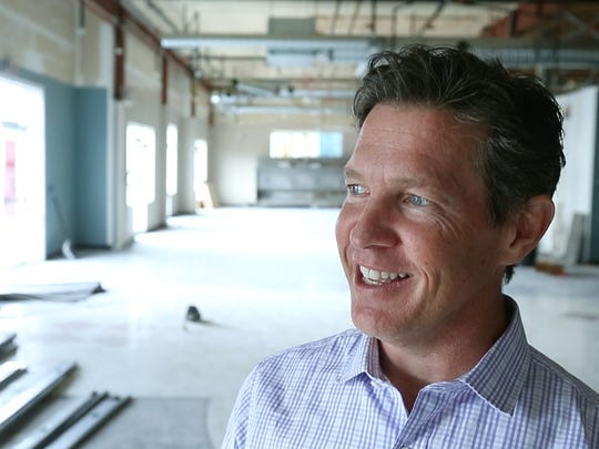 Charlie Fitzsimmons, owner of Village Bakery, TRATA, and other businesses, is developing North 43 The Shops at Main Street in Webster.