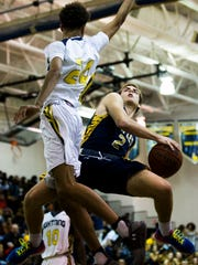 Naples High School point guard, Andre Eaton, goes up
