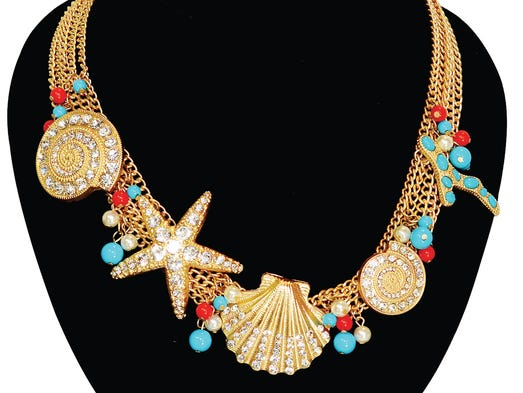 Seashell gold necklace, $39.85, at Atelier Alcaniz .