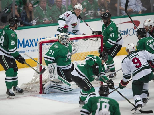 Minnesota Wild center Mikko Koivu (9) shoots and scores a goal against Dallas Stars goalie Antti Niemi (31) to tie the game during the third period in game five of the first round of the 2016 Stanley Cup Playoffs at the American Airlines Center.
